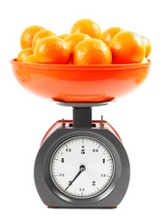Tangerines on scales