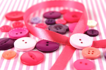 Pink and purple haberdashery buttons and craft ribbon