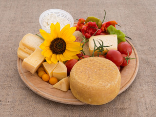 Nature's bounty. Cheese, tomatoes, peppers and sunflower.