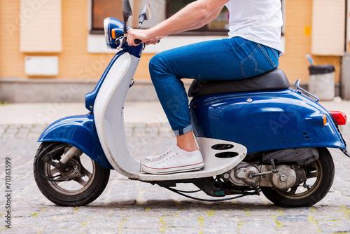 Leinwanddruck Bild Riding along a street.