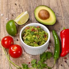 Guacamole with avocado, lime, tomato and cilantro