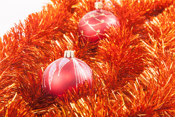 Red Christmas balls on the background of red tinsel