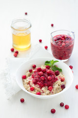 Oatmeal with cranberry jam, fresh cranberries and honey