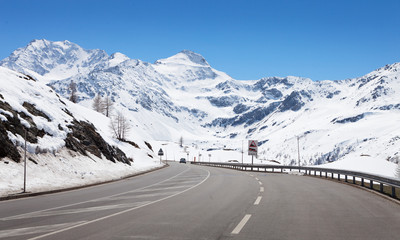 Mountain road in a sunny day.  Simplon Pass, Valais, Switzerland