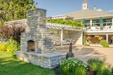 Backyard Patio with Gazebo and Big Brick Fireplace - 70367721