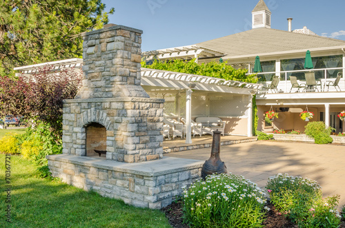 Backyard Patio with Gazebo and Big Brick Fireplace - 70367721
