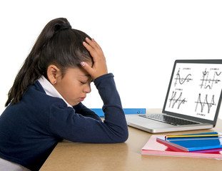 spanish little schoolgirl bored with computer maths homework