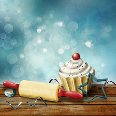 cake, rolling pin,  molds for baking , candy and serpentine on t