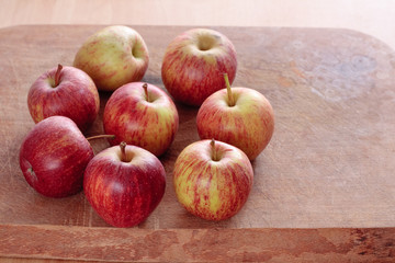Rustic apples on wooden board