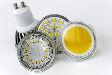 four GU10 LED bulbs with different sizes of chips used