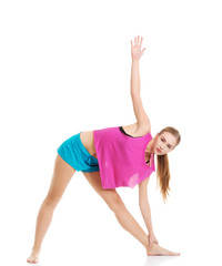 Young healthy girl doing stretching exercises