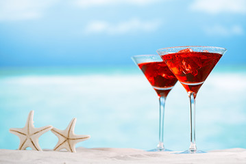 red drink on beach , ocean ,white sand beach and seascape