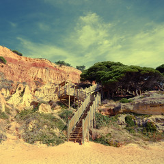 red cliffs, pine and wooden staircase(Algarve,Portugal)