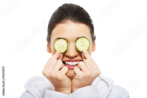 canvas print picture Beautiful woman receiving facial mask of cucumber