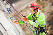 Industrial climber on a building during winterization works - 70370730
