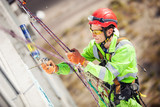 Industrial climber on a building during winterization works