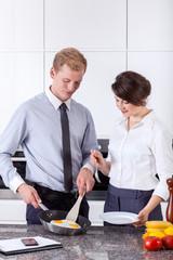 Elegant couple preparing breakfast together