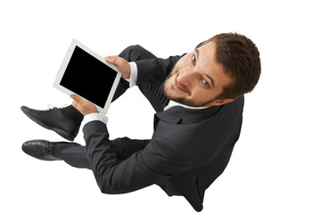 smiley businessman with tablet pc