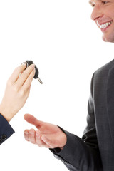Car salesman handing over the keys