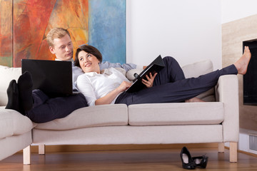 Young couple lying on the sofa