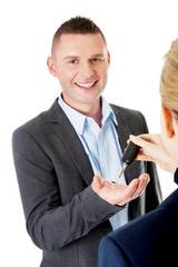 Car salesman handing over the keys