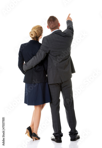 canvas print picture Successful business couple pointing away