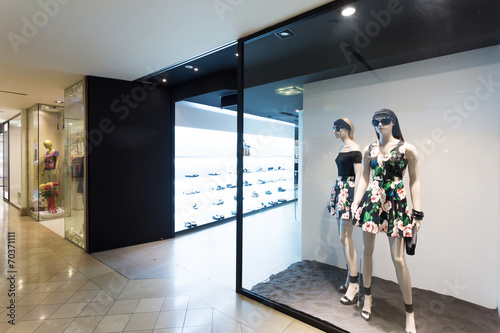 clothes display in the fashion store - 70371111