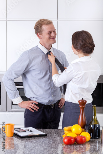 canvas print picture Wife tying tie for husband