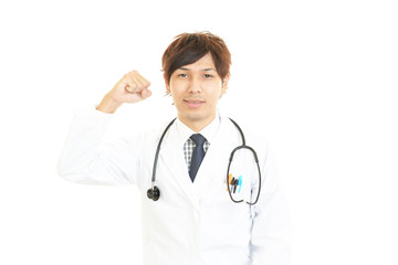 ガッツポーズの医師