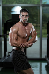 Man Bodybuilder Performing Side Chest Pose