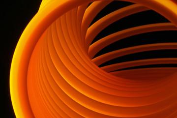 Plastic Slinky toy under blacklight