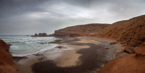 Wild beach on Legzira coast with cliffs in the south of Morocco