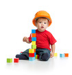 canvas print picture - little kid in hard hat with building blocks