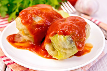 Cabbage stuffed with tomato sauce on plate