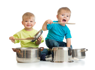 kids playing with pans as they are cooking together isolated