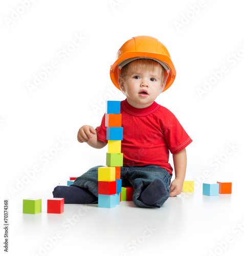 canvas print picture little kid in hard hat with building blocks