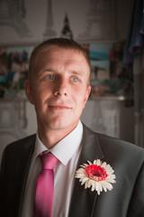 Portrait of Caucasian mid-adult groom