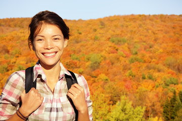Fall hiking woman in autumn forest