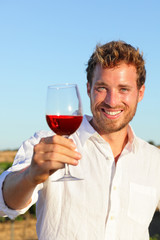 Man drinking rose or red wine toasting