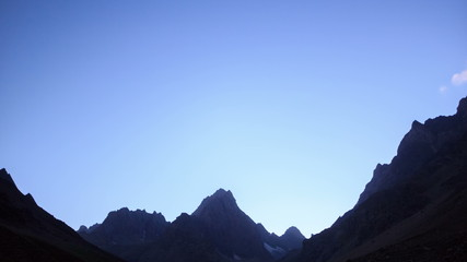 Mountain slopes in the moonlight. Time Lapse. Pamir