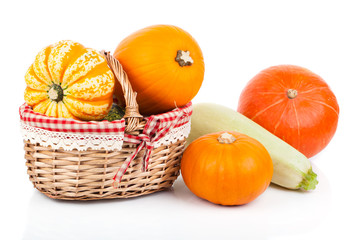 yellow pumpkins vegetables in basket, isolated on white backgrou