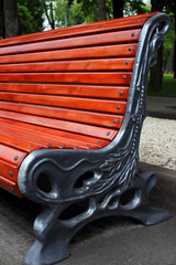 Beautiful bench, standing in a city park.