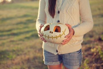 Girls arms holding pumpkin