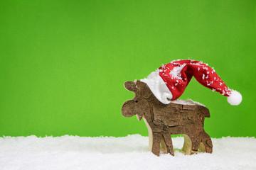 Handgeschnitztes Rentier zu Weihnachten als Weihnachtskarte