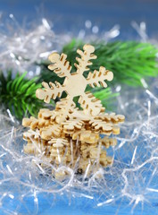 Christmas still life with decorations and wooden snowflakes