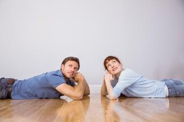 Couple lying on the floor
