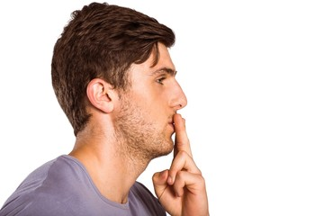 Young man with finger on lips