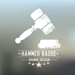 Hammer badge grunge symbol on blur background