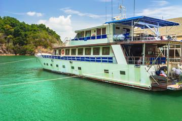 passerger ship floating at port.