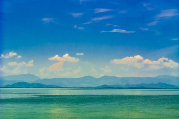 Seascape and mountain on bluesky background.